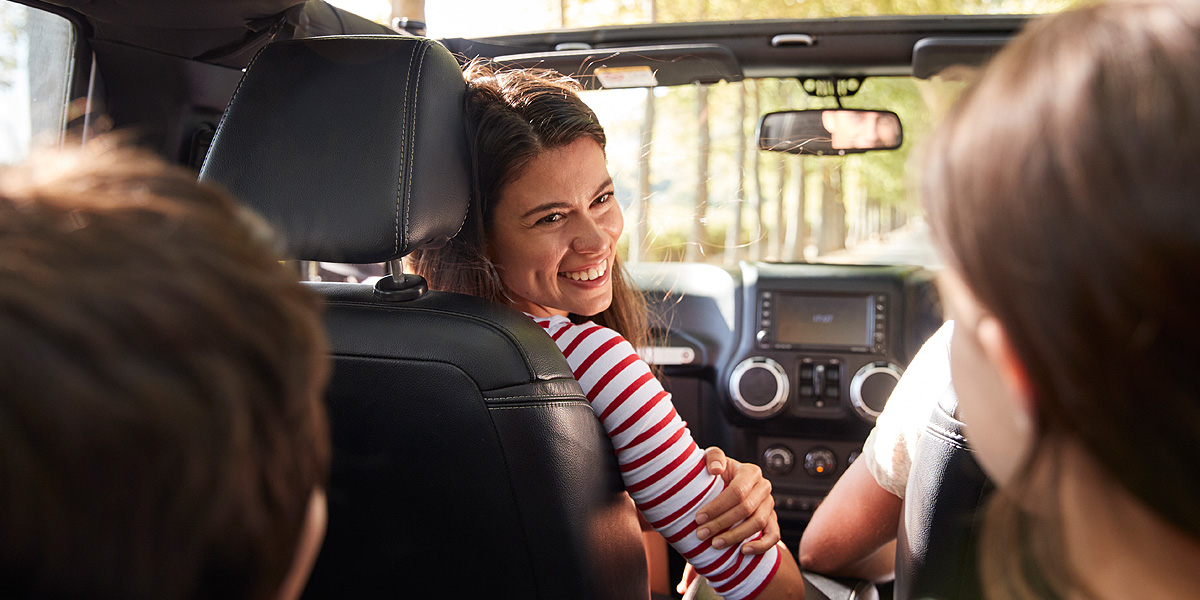 Image of a woman in a car looking at two children in the backseat  Text: When we come together, we are better. And PeepsRide is here to help you do all this effortlessly. And affordably.